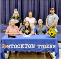 Macy Odle with coaches and AD